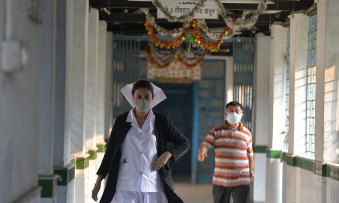 A nurse wearing a facemask walks inside an isolation ward opened as a preventative measure at the North Bengal Medical college and Hospital in Siliguri on Feb. 4, 2020. (ADiptendu Dutta/AFP via Getty Images)