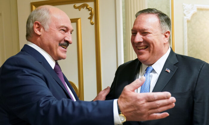 Belarusian President Alexander Lukashenko greets U.S. Secretary of State Mike Pompeo during a meeting in Minsk, Belarus, on Feb. 1, 2020. (Kevin Lamarque/Pool/Reuters)