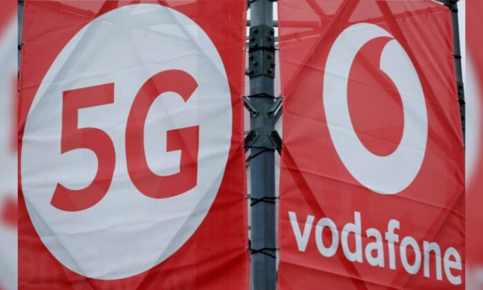 Logos of 5G technology and telecommunications company Vodafone are pictured at the 5G Mobility Lab of Vodafone in Aldenhoven, Germany, on Nov. 27, 2018. (Thilo Schmuelgen/File Photo/Reuters)