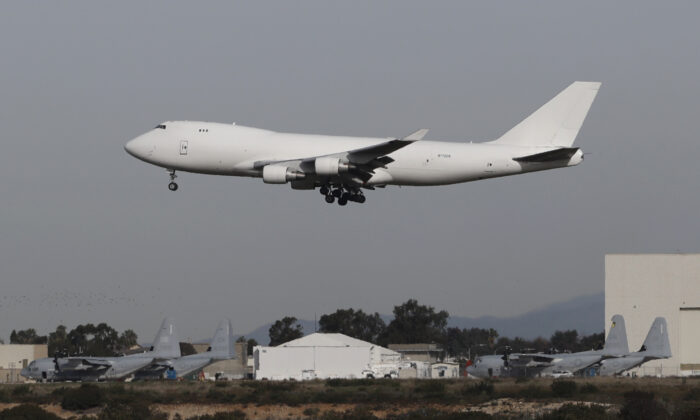 A plane carrying evacuees from the virus zone in China lands at Marine Corps Air Station Miramar in San Diego, Calif., on Feb. 5, 2020. (Gregory Bull/AP Photo)
