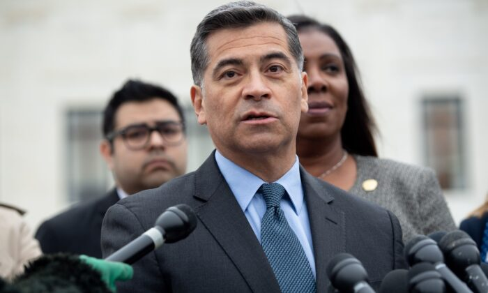 California Attorney General Xavier Becerra speaks outside the US Supreme Court in Washington on Nov. 12, 2019. (SAUL LOEB/AFP via Getty Images)