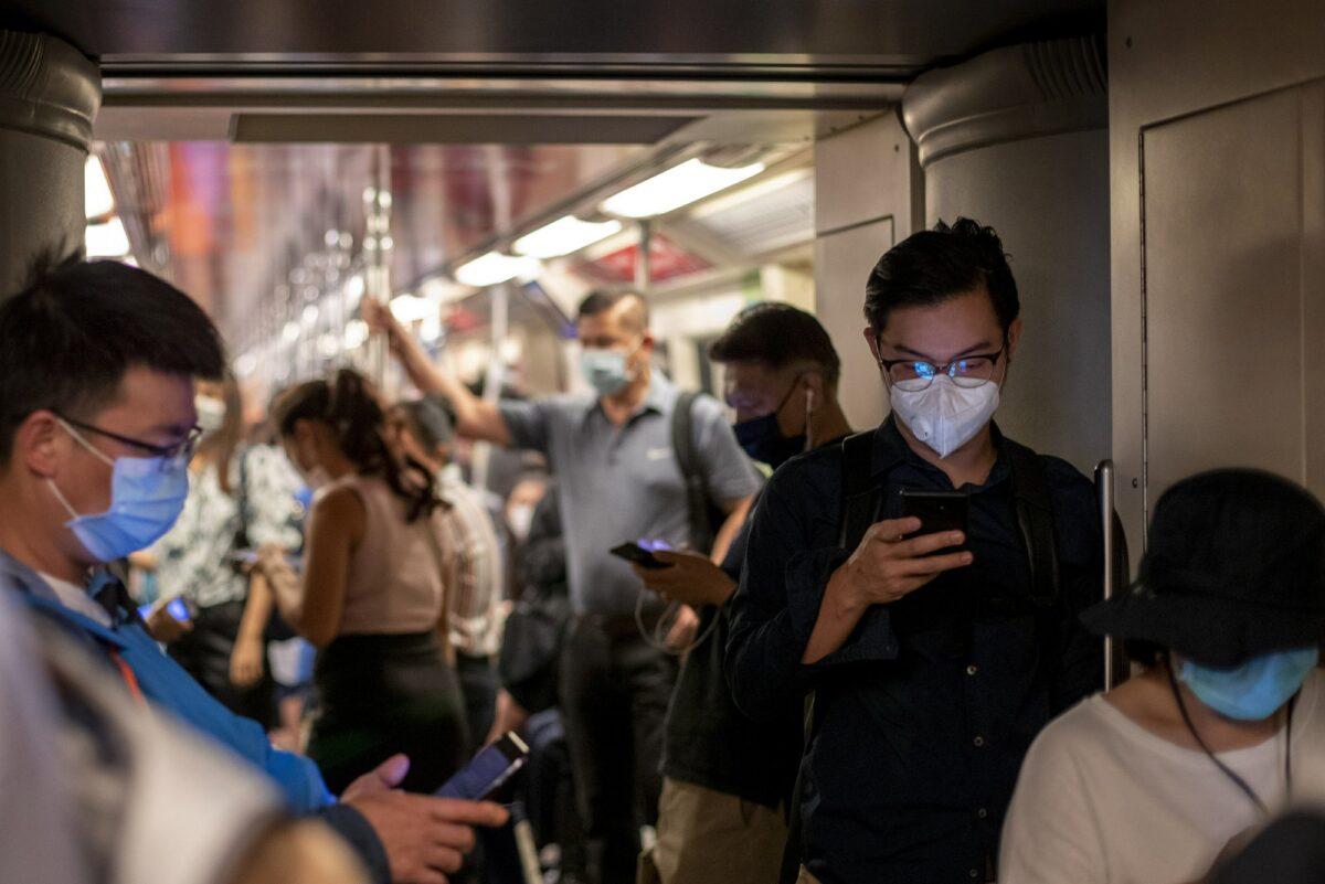 Commuters wear facemasks in Bangkok