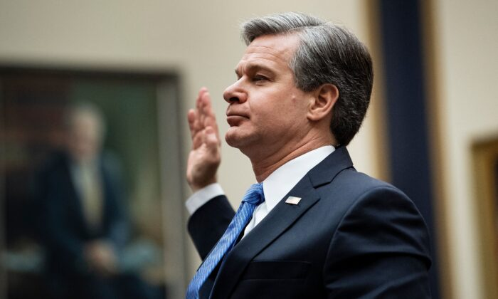 "FBI Director Christopher Wray takes the oath before a full committee hearing on ""Oversight of the Federal Bureau of Investigation"" on Capitol Hill on Feb. 5, 2020. (Brendan Smialowski/AFP via Getty Images)"