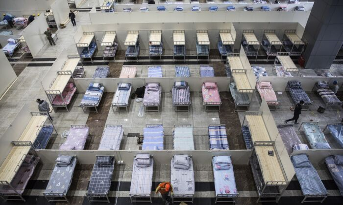 Workers continue to prepare beds at Wuhan International Conference and Exhibition Center in Wuhan, China on Feb. 4, 2020. (Getty Images)