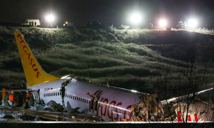 The crash site of a Pegasus Airlines Boeing 737 airplane, after it skidded off the runway upon landing at Sabiha Gokcen airport in Istanbul, Turkey, on Feb. 5, 2020.  (STR/AFP via Getty Images)