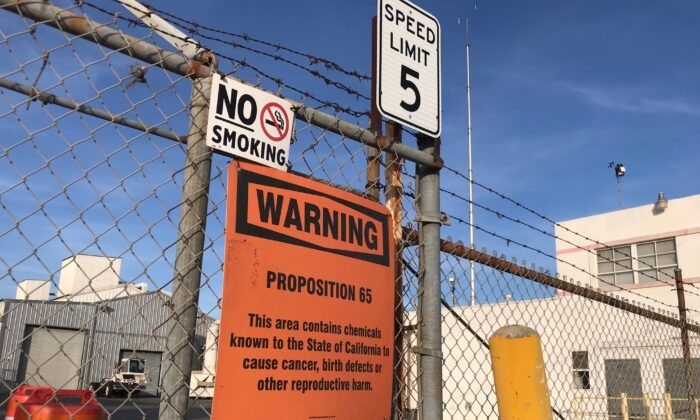 A sign outside a shuttered Exide Technologies battery recycling plant in Commerce, Calif., on Jan. 31, 2020. The plant was the source of lead and arsenic pollution covering neighborhoods in the surrounding 1.7 miles. (Chris Karr/The Epoch Times)