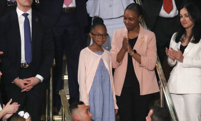 Stephanie Davis and her daughter Janiyah, attend the State of the Union address in the chamber of the U.S. House of Representatives, on February 04, 2020. (Drew Angerer/Getty Images)