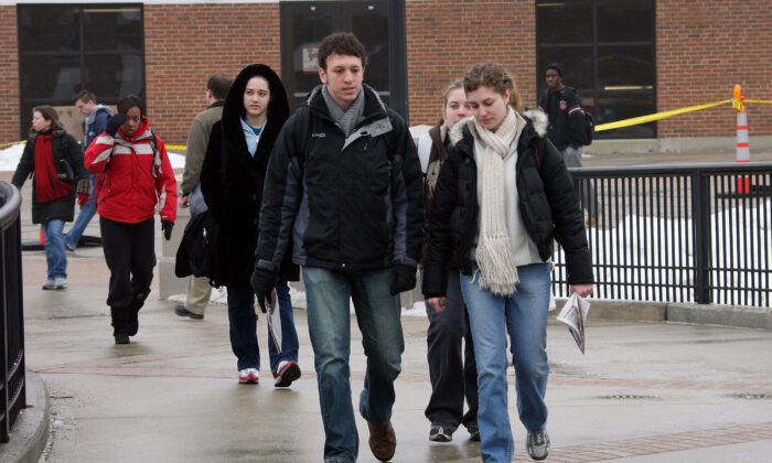 Students pass by Cole Hall as they walk to class at Northern Illinois University in DeKalb, Ill., on Feb. 25, 2008. (Scott Olson/Getty Images)