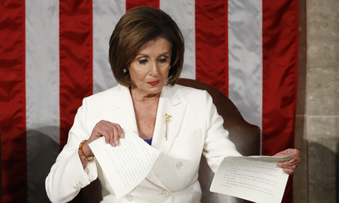 House Speaker Nancy Pelosi (D-Calif.) tears her copy of President Donald Trump's State of the Union address after he delivered it to a joint session of Congress on Capitol Hill in Washington, on Feb. 4, 2020. (Patrick Semansky/AP Photo)