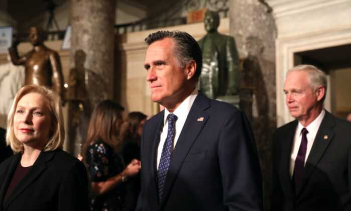 Sen. Mitt Romney (R-Utah) walks through Statuary Hall with other senators to the House Chamber for President Donald Trump's State of the Union address in the Capitol in Washington on Feb. 4, 2020. (Charlotte Cuthbertson/The Epoch Times)