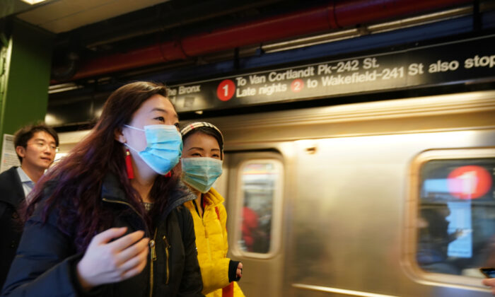 People wear surgical masks in the subway station at Times Square in New York on Jan. 31, 2020. (Bryan R Smith/Reuters)