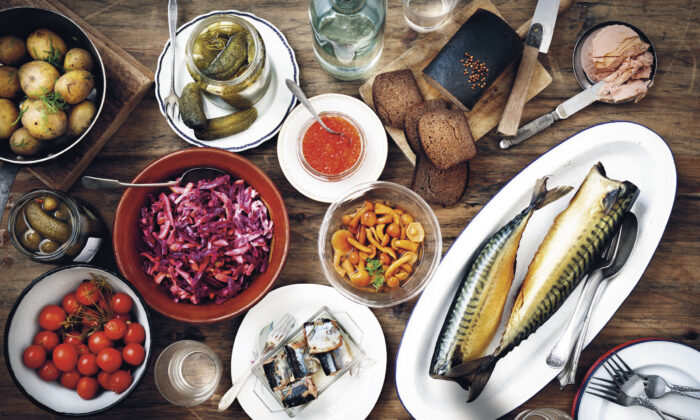 A spread of zakuski, the 'little bites'—often pickled, brined, smoked, or cured—traditionally served at the start of a Russian meal. (Stefan Wettainen)