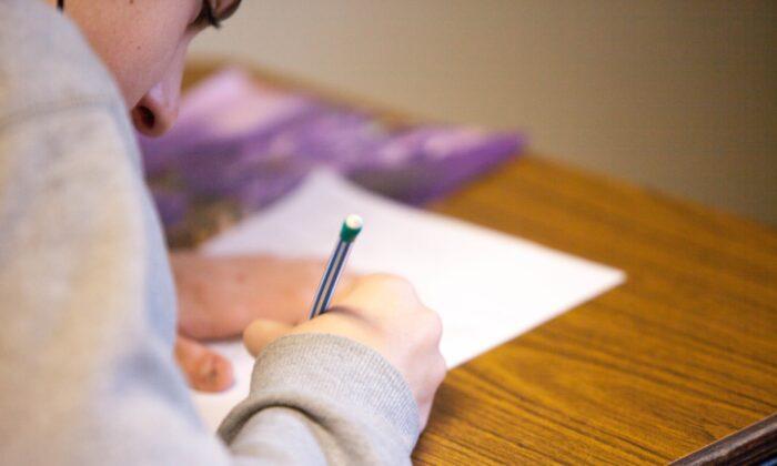 Stock photo of a student writing. (Ben Mullins/Unsplash)
