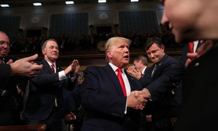 President Donald Trump arrives to deliver the State of the Union address in the House chamber on Feb. 4, 2020. Trump delivered his third State of the Union address on the night before the U.S. Senate is set to vote in his impeachment trial. (Leah Millis-Pool/Getty Images)