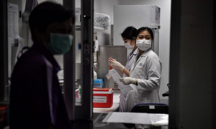 Lab technicians register samples from potential victims of the Novel Coronavirus at the Center for Emerging Infectious Diseases of Thailand at Chulalongkorn University in Bangkok on Feb. 5, 2020. (Lillian Suwanrumpha/AFP via Getty Images)