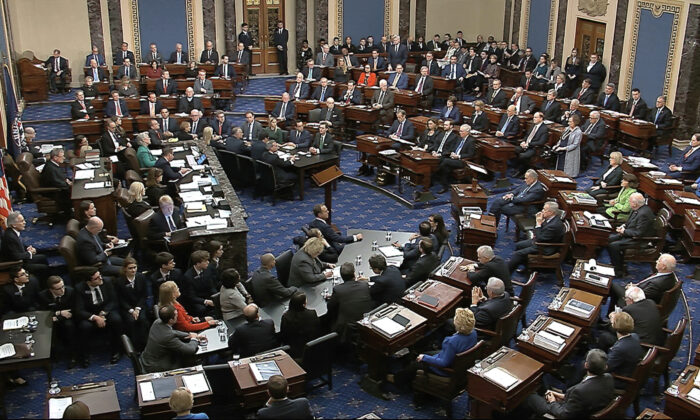 In this image from video, Senators vote on the first article of impeachment during the impeachment trial against President Donald Trump in the Senate at the U.S. Capitol in Washington, Wednesday, Feb. 5, 2020. (Senate Television via AP)