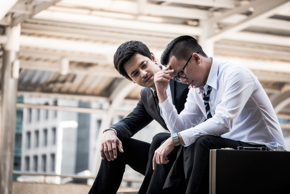 Frustrated Asian young business man