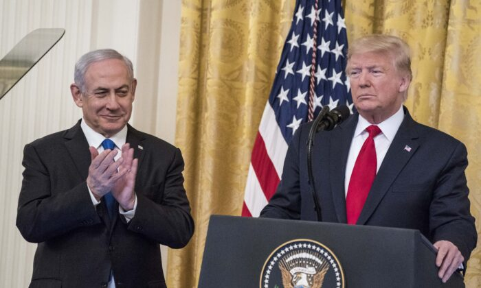 President Donald Trump and Israeli Prime Minister Benjamin Netanyahu participate in a joint statement in the East Room of the White House on Jan. 28, 2020. (Sarah Silbiger/Getty Images)