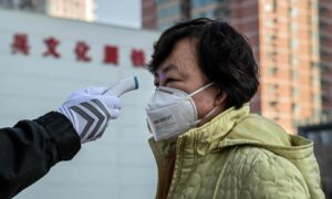 Chinese Top Official Orders Wuhan, Epicenter of Coronavirus Outbreak, to Screen Every Resident's Body Temperature