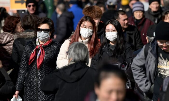 People wear surgical masks in fear of the coronavirus in Flushing, a neighborhood in the New York City borough of Queens on Feb. 3, 2020. (Johannes Eisele/AFP via Getty Images)