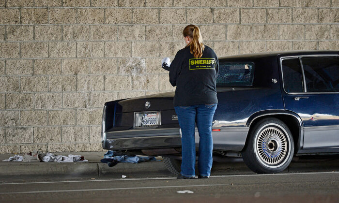 A file photo of Orange County Sheriff deputies investigating a crime scene in Tustin, Calif., on Feb. 19, 2013. (Kevork Djansezian/Getty Images)