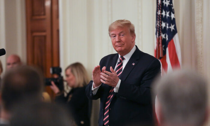 President Donald Trump applauds a day after being acquitted in two articles of impeachment, in the East Room of the White House in Washington on Feb. 6, 2020. (Charlotte Cuthbertson/The Epoch Times)