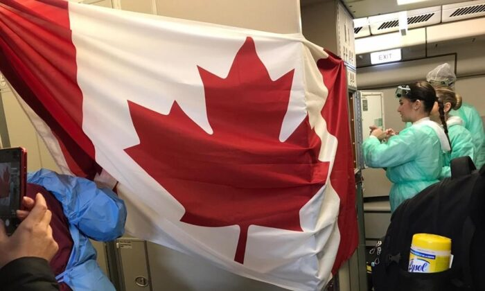 A Canadian flag is hung up as people board a plane destined for Canada at the Wuhan Tianhe International Airport early in the morning on Feb. 7, 2020 in this handout photo provided by Myriam Larouche. (The Canadian Press/HO, Myriam Larouche)