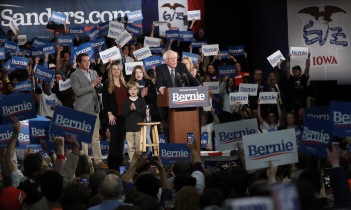Democratic presidential candidate Sen. Bernie Sanders (I-Vt.) accompanied by his family, speaks to supporters at a caucus night campaign rally in Des Moines, Iowa, on Feb. 3, 2020. (Pablo Martinez Monsivais/AP Photo)