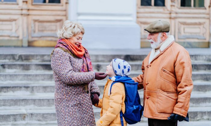 Walking your grandchild to and from school is a great way to get some gentle exercise. (Iryna Inshyna/Shutterstock)