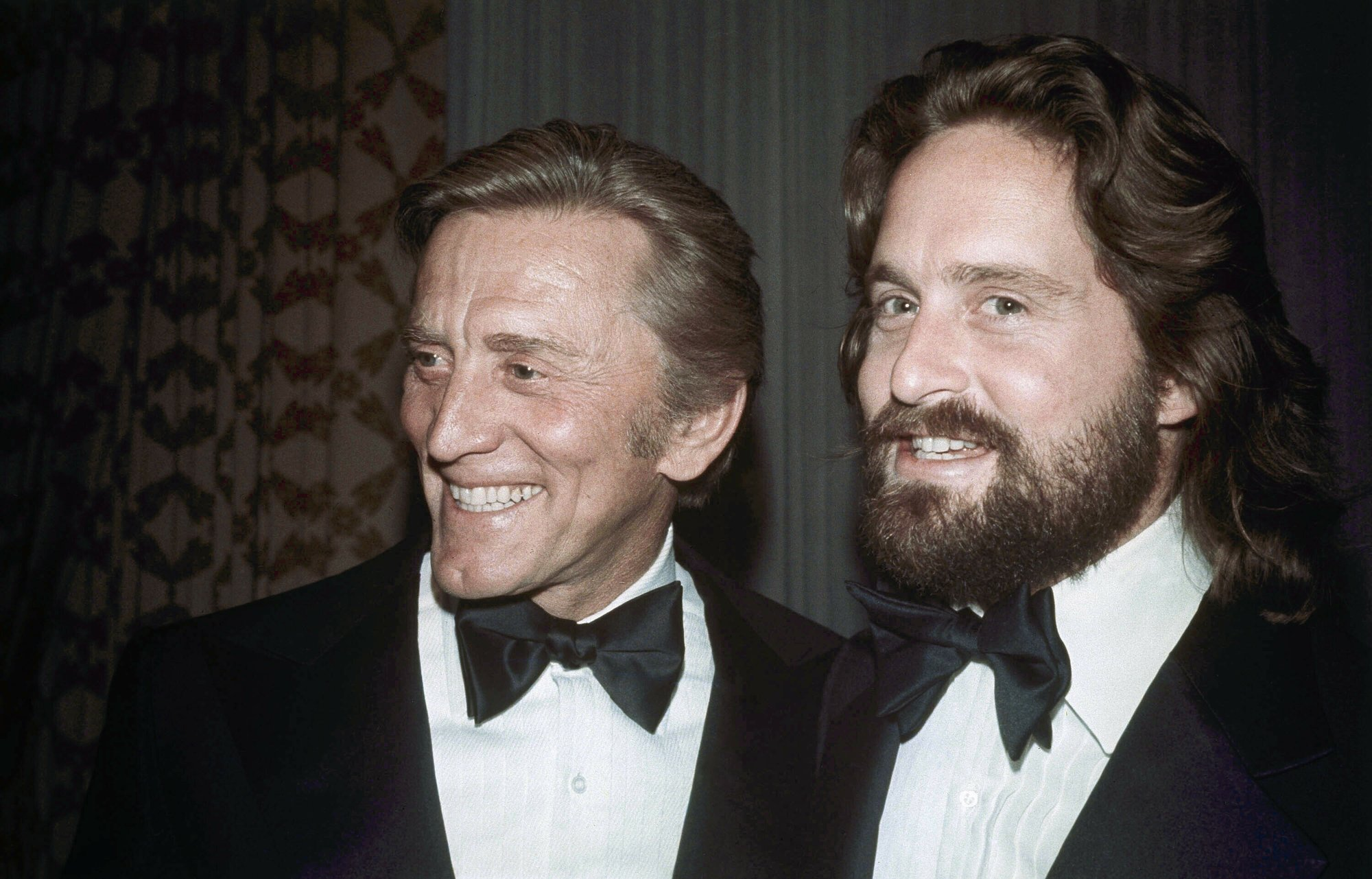 Father-son actors Kirk Douglas, left, and Michael Douglas