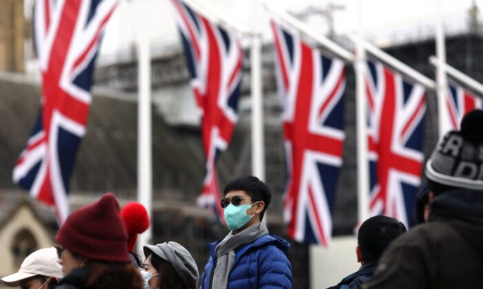 People wearing face masks are pictured on Parliament Square, on Brexit day, in London, Britain, on Jan. 31, 2020. (Simon Dawson/Reuters)