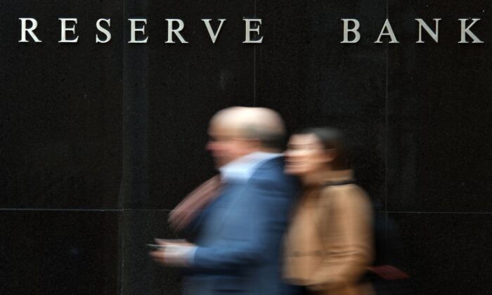 People walk past the Reserve Bank of Australia building in Sydney on May 7, 2019. (Saeed Khan/AFP via Getty Images)