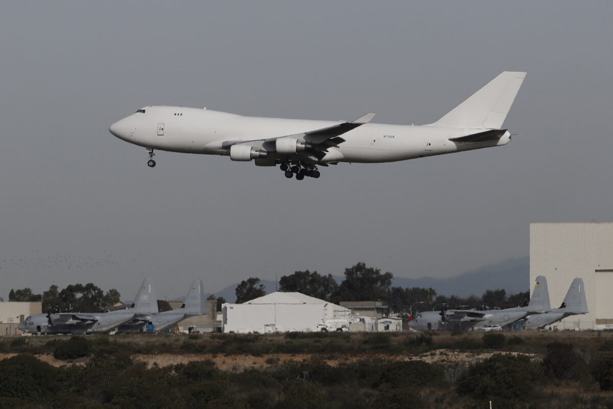 A plane carrying evacuees from the virus zone in China