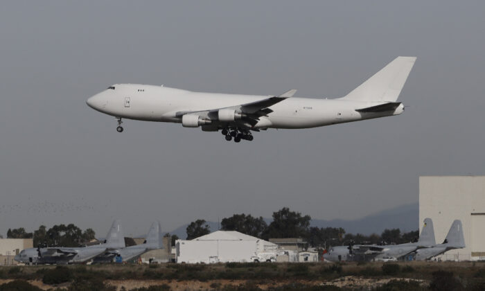 A plane carrying evacuees from the virus zone in China lands at Marine Corps Air Station Miramar , in San Diego,on Feb. 5, 2020. (Gregory Bull/AP)