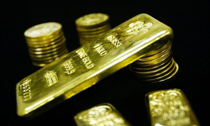 Gold bullion bars and coins are seen for sale, in this file photo. (Mario Tama/Getty Images)
