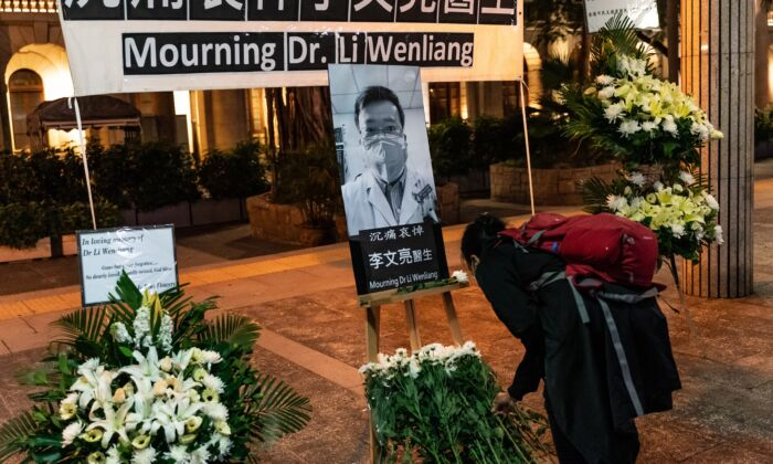 People attend a vigil to mourn for doctor Li Wenliang in Hong Kong on Feb. 7, 2020. (Anthony Kwan/Getty Images)