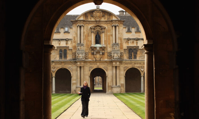 A woman walks through Canterbury Quadrangle in St John's College in Oxford, England, on March 22, 2012.  (Oli Scarff/Getty Images)