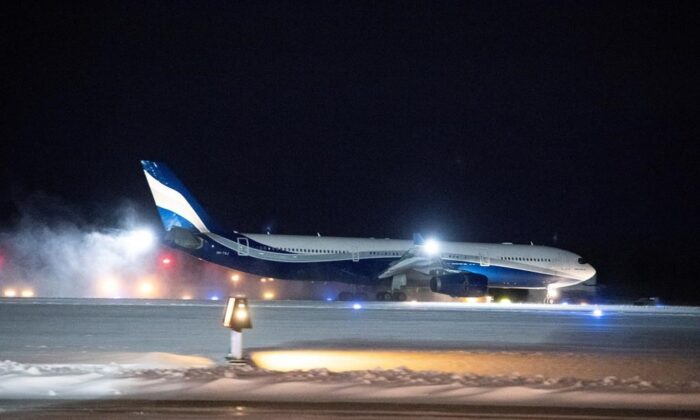A plane carrying 176 Canadian citizens from the centre of the global novel coronavirus outbreak in Wuhan, China, lands at CFB Trenton, in Trenton, Ont., on Feb. 7, 2020. (The Canadian Press/Justin Tang)