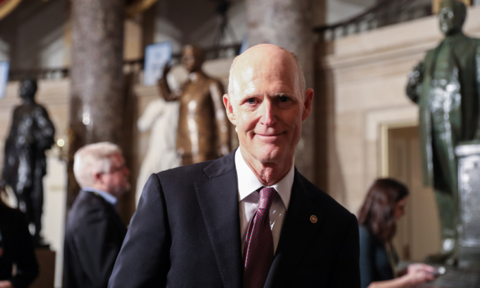 Sen. Rick Scott (R-Fla.) walks through Statuary Hall to the House Chamber for President Donald Trump's State of the Union address in the Capitol in Washington on Feb. 4, 2020. (Charlotte Cuthbertson/The Epoch Times)