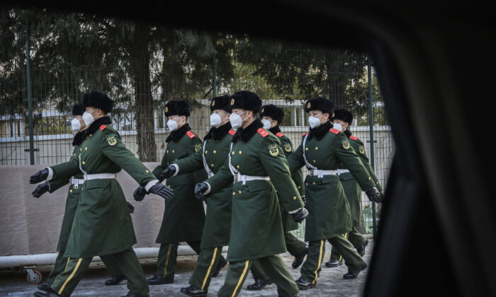Chinese police march wearing masks during a duty change in Beijing on Feb. 3, 2020. (Kevin Frayer/Getty Images)