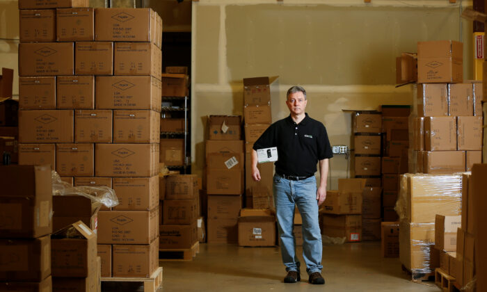 Bernie Thompson of Plugable Technologies holds a docking station that he sells on Amazon.com from his facility in Redmond, Washington, U.S., on Feb. 6, 2020. (Lindsey Wasson/Reuters)