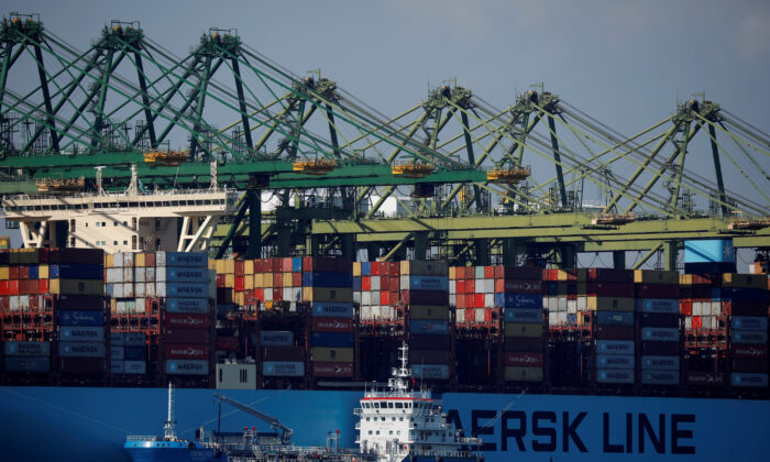 A container ship is berthed at PSA's Pasir Panjang Terminal in Singapore on July 15, 2019. (Edgar Su/Reuters)