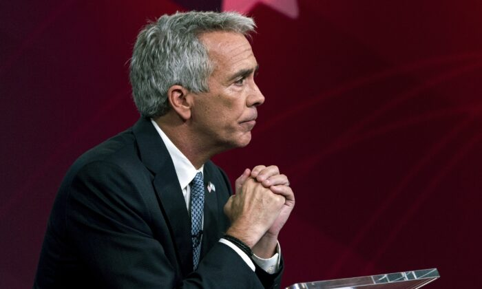 In this Sept. 24, 2019, file photo, Republican presidential candidate and former Rep. Joe Walsh (R-Ill.) listens to a question during a debate in New York. Walsh said Feb. 7, 2020, he is suspending his campaign. (Julius Constantine Motal/AP Photo)