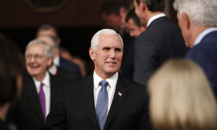 U.S. Vice President Mike Pence arrives in front of Senate Majority Leader Mitch McConnell for U.S. President Donald Trump's State of the Union address to a joint session of the U.S. Congress in the House Chamber of the U.S. Capitol in Washington, D.C. on Feb. 4, 2020. (Leah Millis/Reuters)