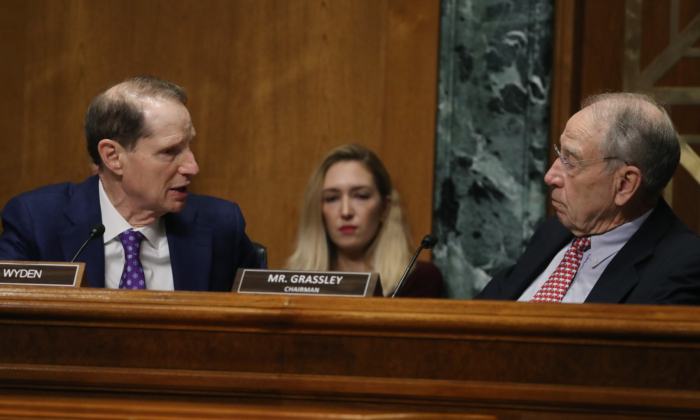 Sen. Ron Wyden (D-Ore.) (L) talks with Chairman Chuck Grassley (R-Iowa) during a Senate Finance Committee committee hearing on Capitol Hill in Washington on Oct. 24, 2019. (Mark Wilson/Getty Images)