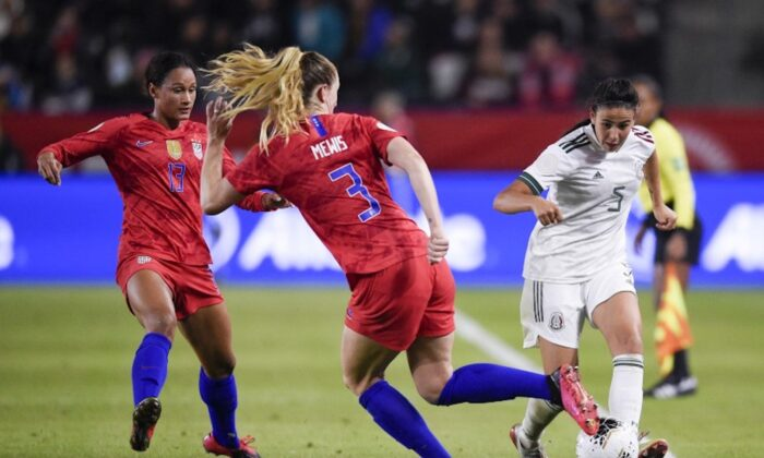 Feb 7, 2020; Los Angeles, California, USA; Mexico defender Jimena Lopez (5) passes the ball while United States midfielder Samantha Mewis (3) defends during the second half of the CONCACAF Women's Olympic Qualifying soccer tournament at Dignity Health Sports Park. (Photo by Kelvin Kuo-USA TODAY Sports)