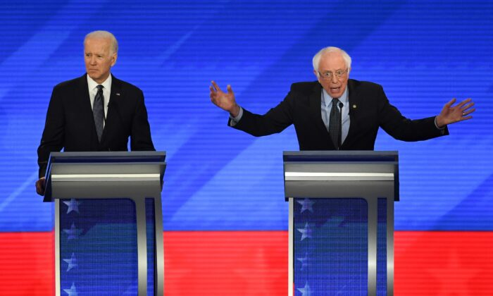 Democratic presidential hopeful former Vice President Joe Biden, left, and Sen. Bernie Sanders (I-Vt.) during the eighth Democratic primary debate of the 2020 presidential campaign season at St. Anselm College in Manchester, N.H., on Feb. 7, 2020. (Timothy A. Clary/AFP via Getty Images)
