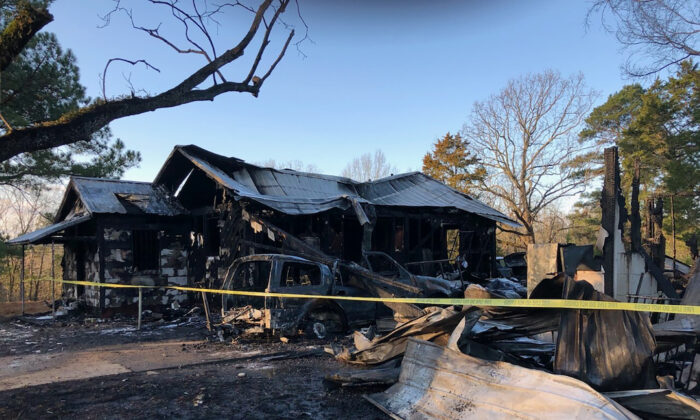 Damage to a house after a fatal fire in Clinton, Miss., on Feb. 8, 2020.  (Reggi Marion/WLBT-TV via AP)