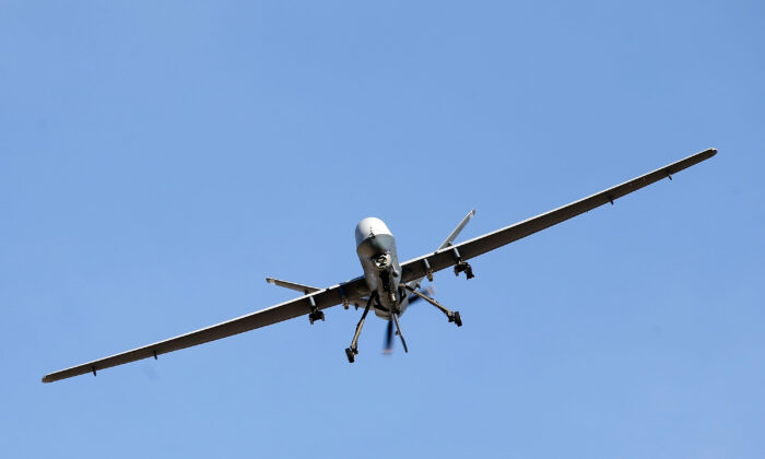 An MQ-9 Reaper remotely piloted aircraft flies in a training mission in Nevada in a file photograph. (Isaac Brekken/Getty Images)