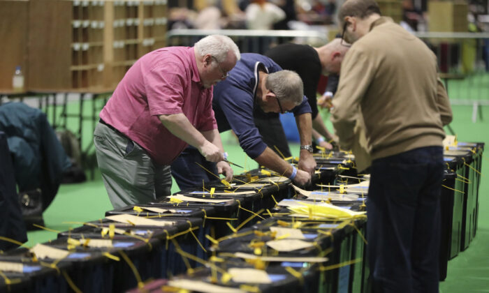 Ballot boxes are opened at the start of the Irish General Election count in Dublin, on Feb. 9, 2020. (Niall Carson/PA via AP)